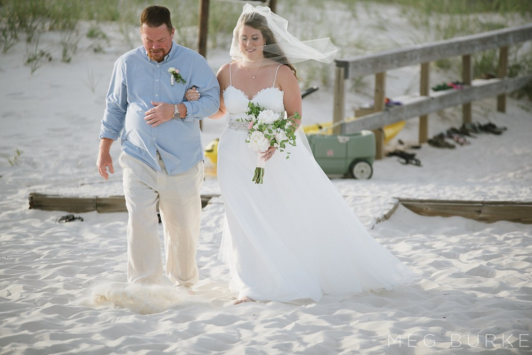 father walking bride down the aisle at beach wedding