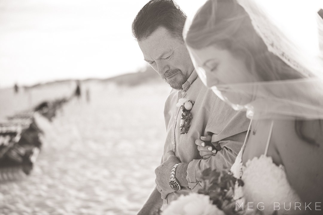 father walks bride down the aisle of beach wedding