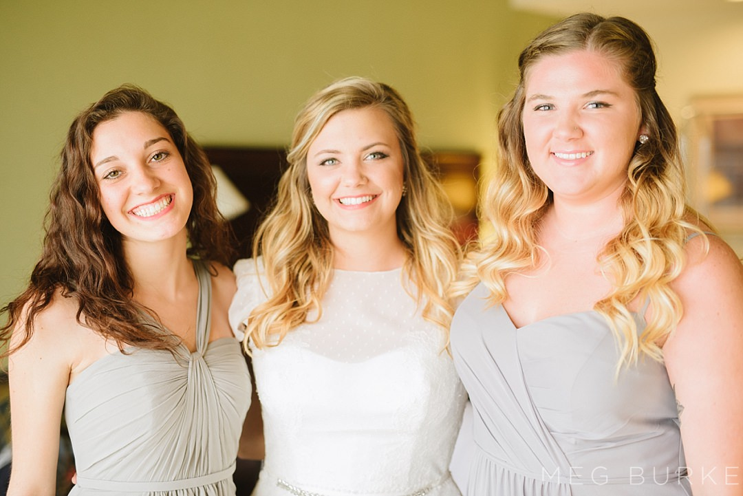 bride and bridesmaids with grey dresses