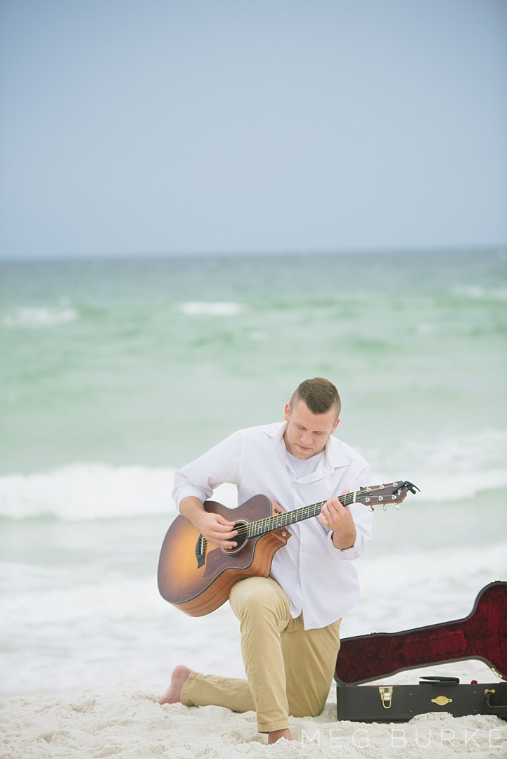 guitarist by the ocean for southern beach wedding cermeony