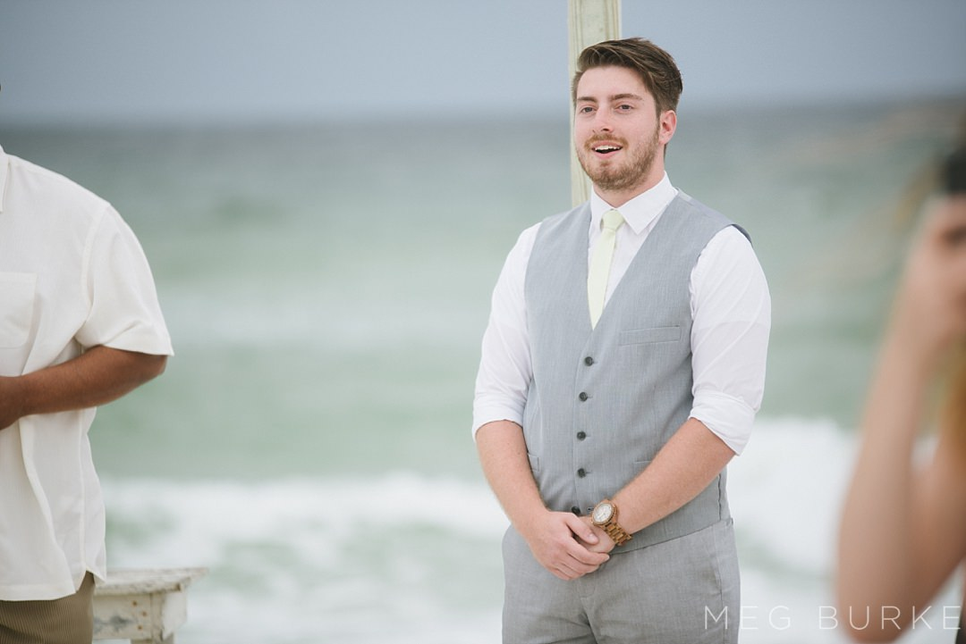 groom's first look of bride down the aisle of a southern beach wedding