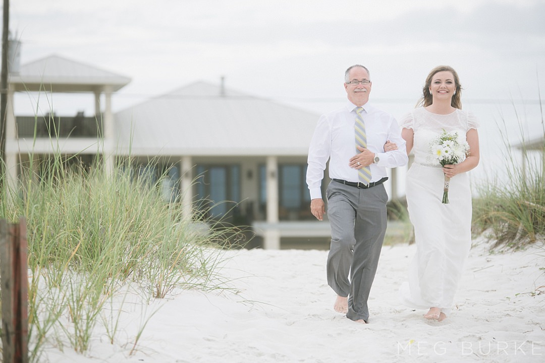 bride and father walking down aisle of pensacola beach ceremony