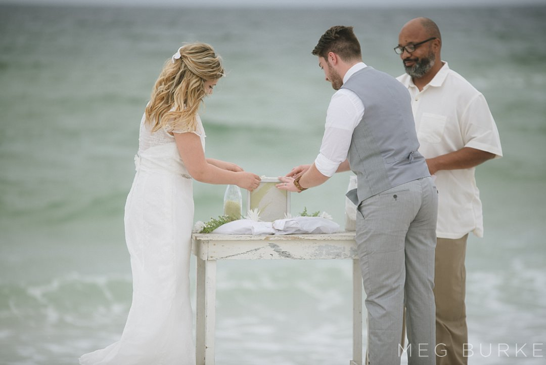 sand ceremony on Pensacola Beach during stormy wedding day