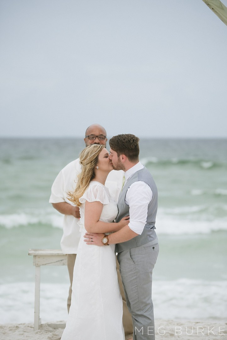 bride and groom's first kiss at a southern beach wedding