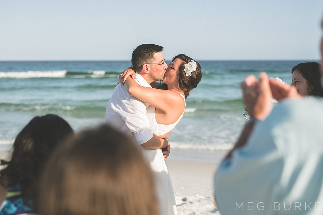 first kiss at small family beach wedding