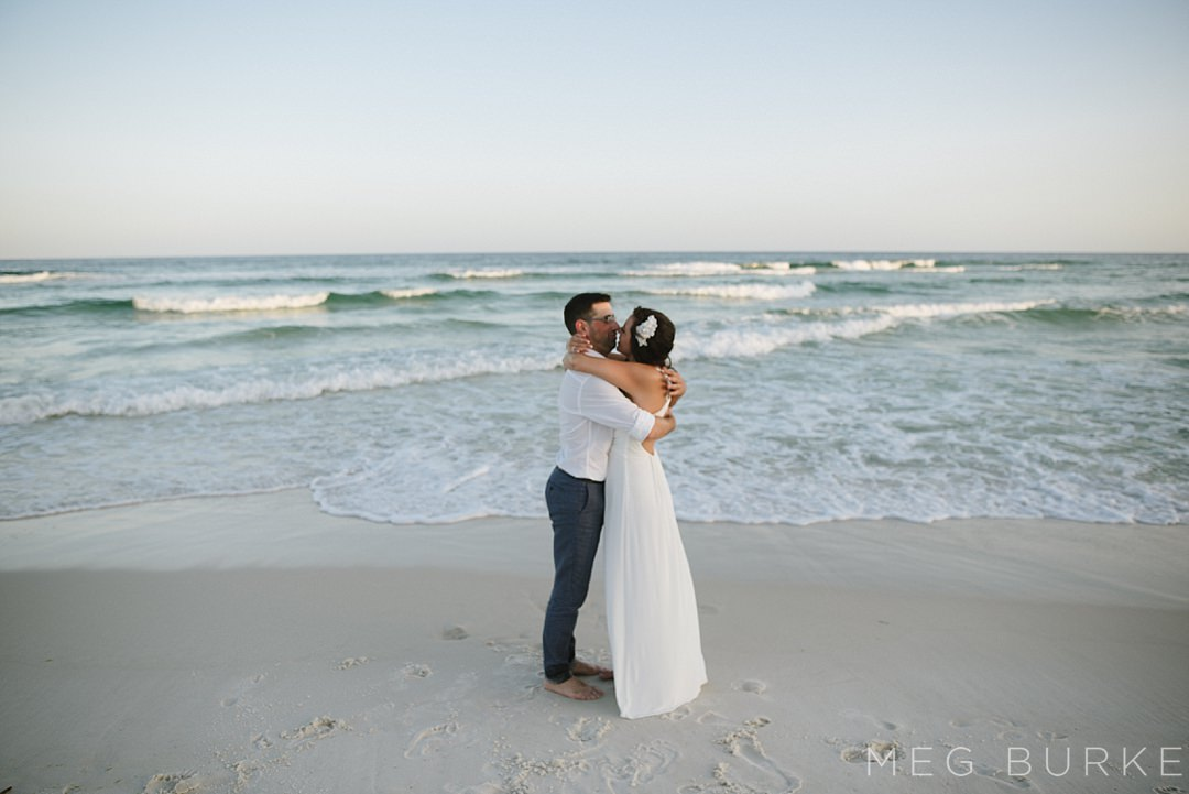 bride and groom with pensacola gulf