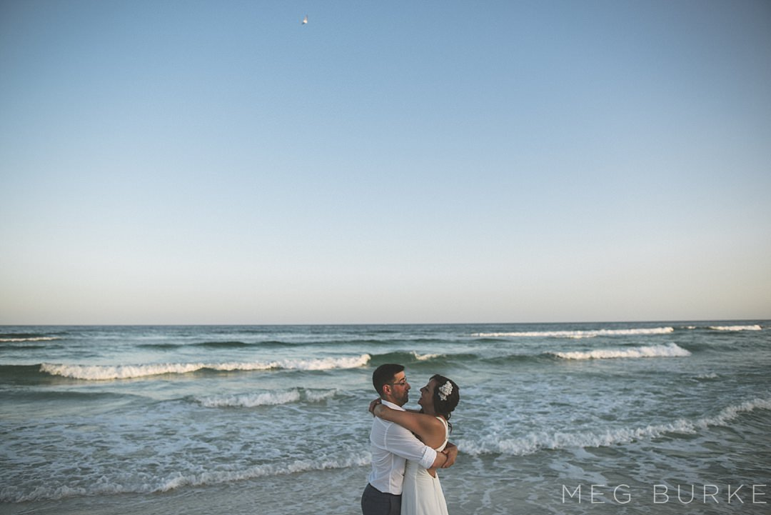 bride and groom at sunset on pensacola beach