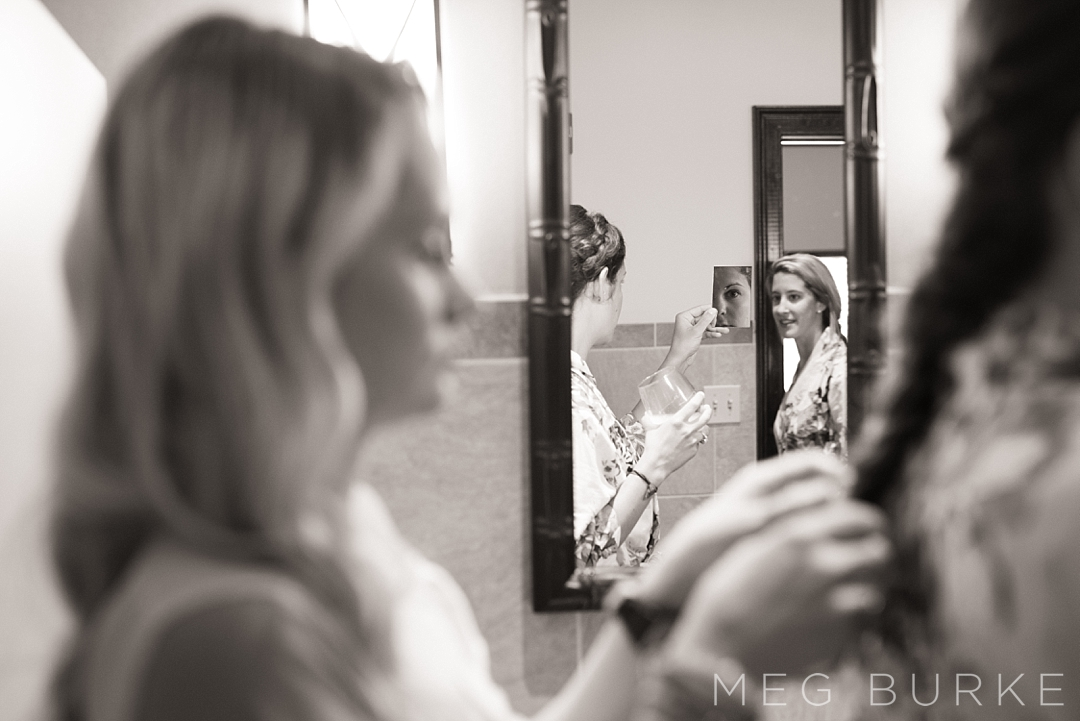 Bride getting ready with mirror