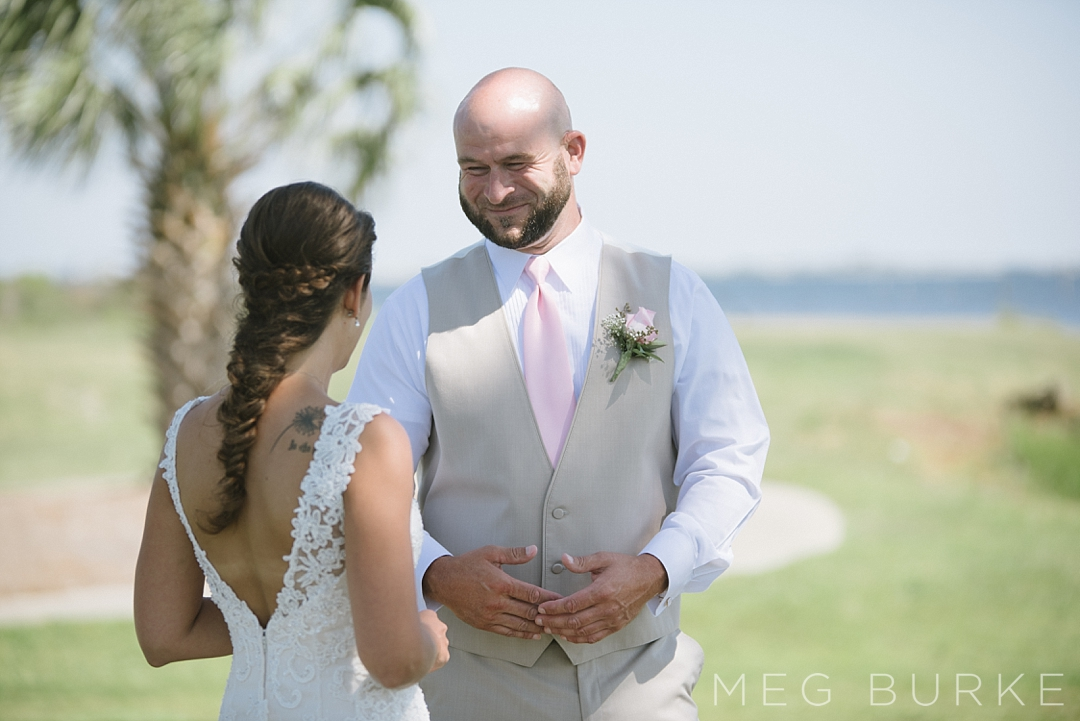 Bride and groom first look on golf course