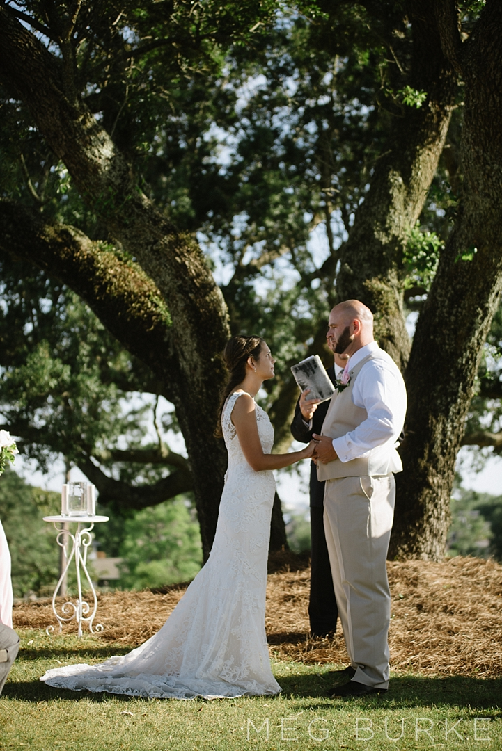 Exchanging vows by oak tree
