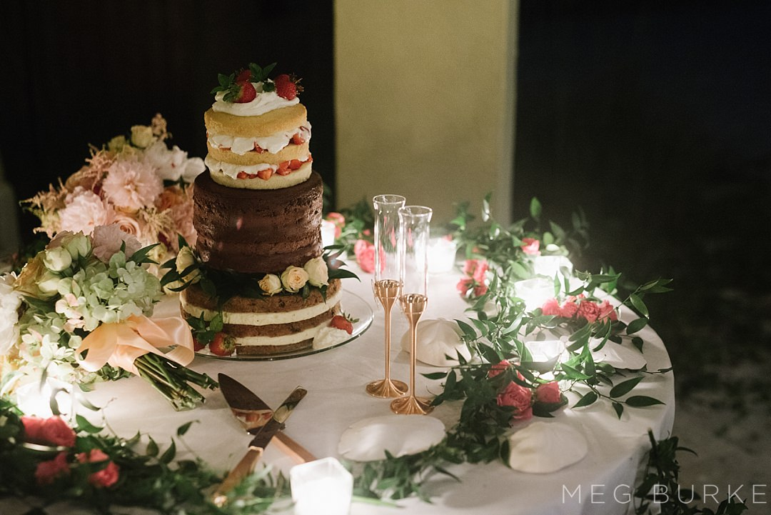 naked wedding cake and gold champagne flutes