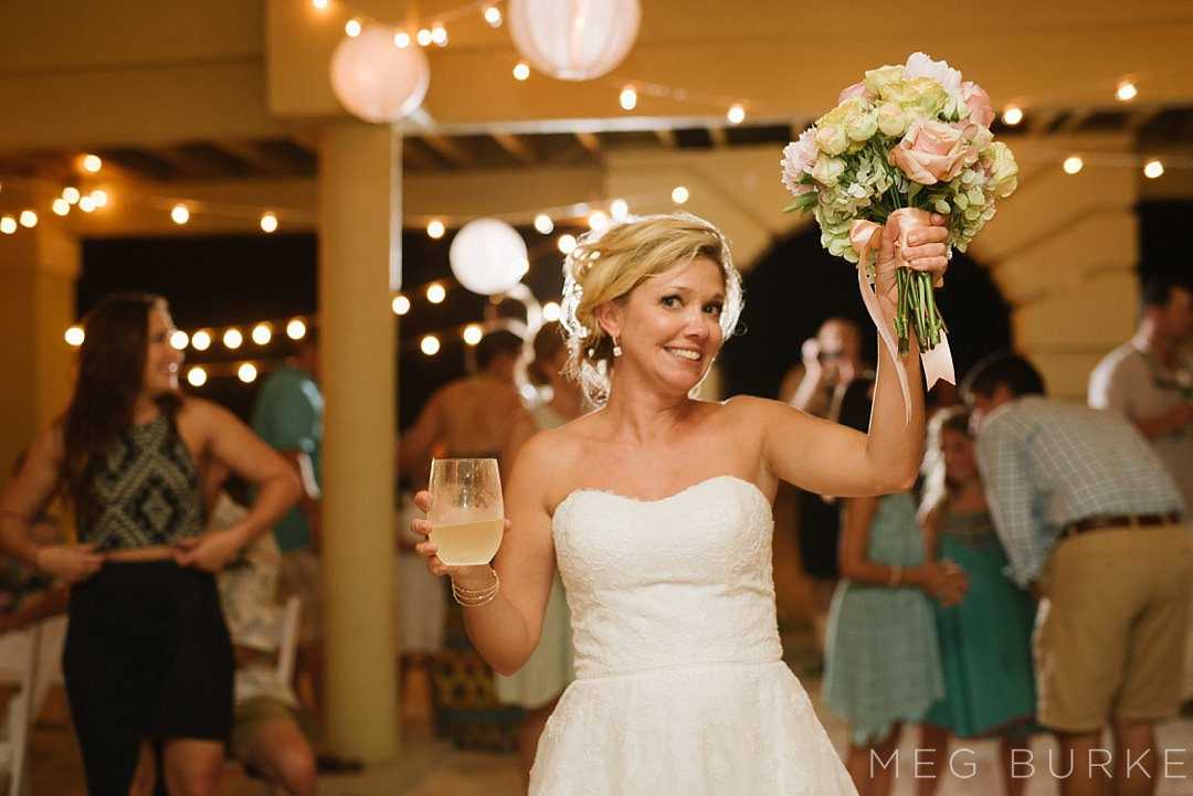 bride throwing bouquet with glass