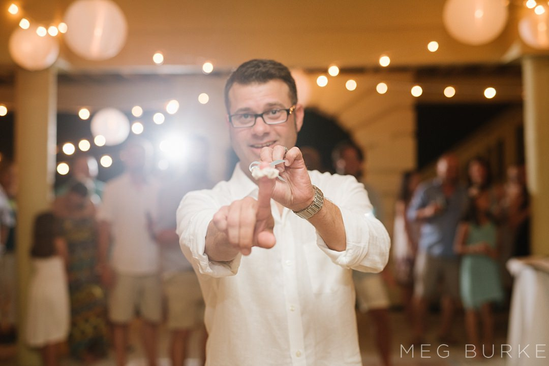 groom throwing garter