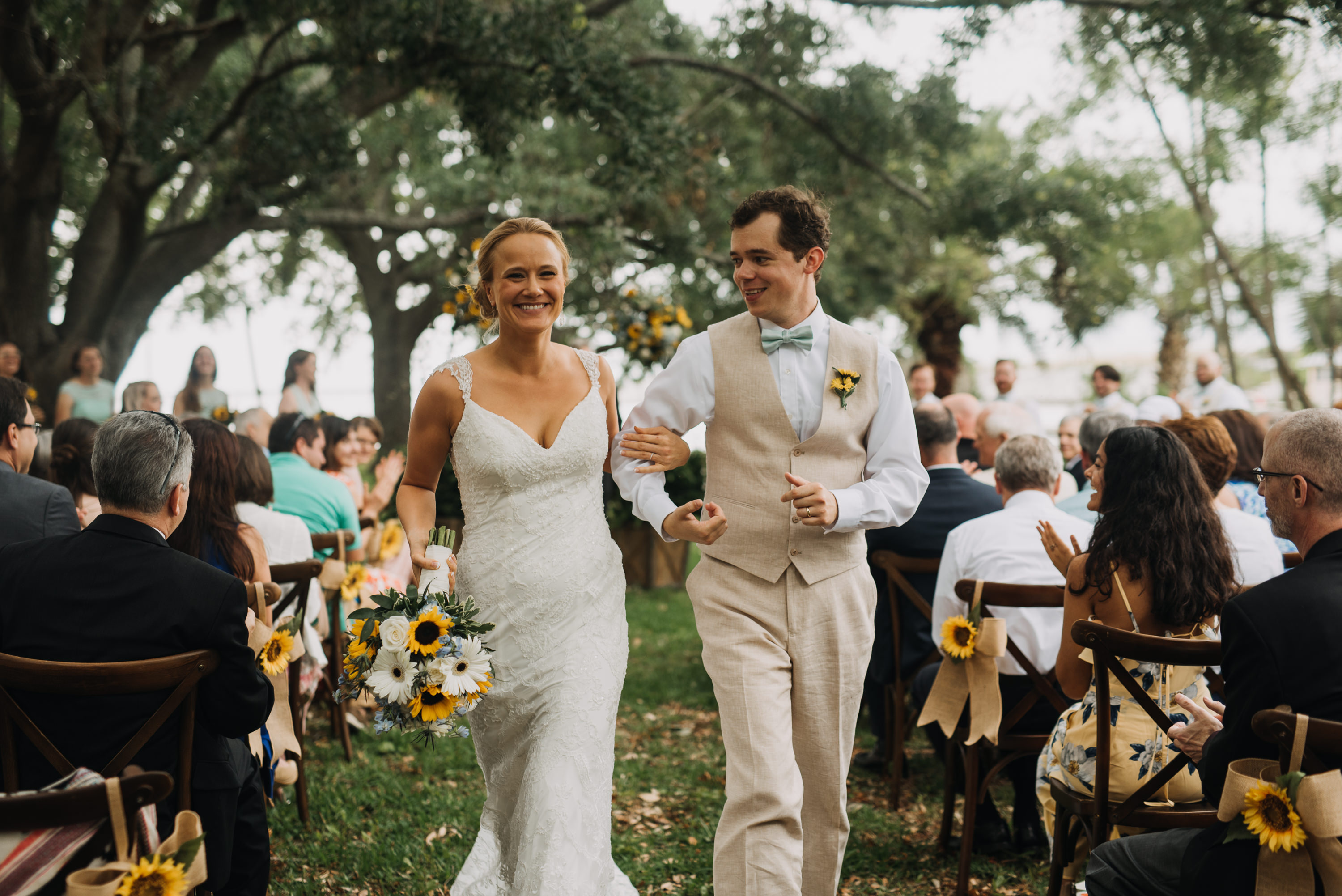 bride and groom exit outdoor pensacola park wedding
